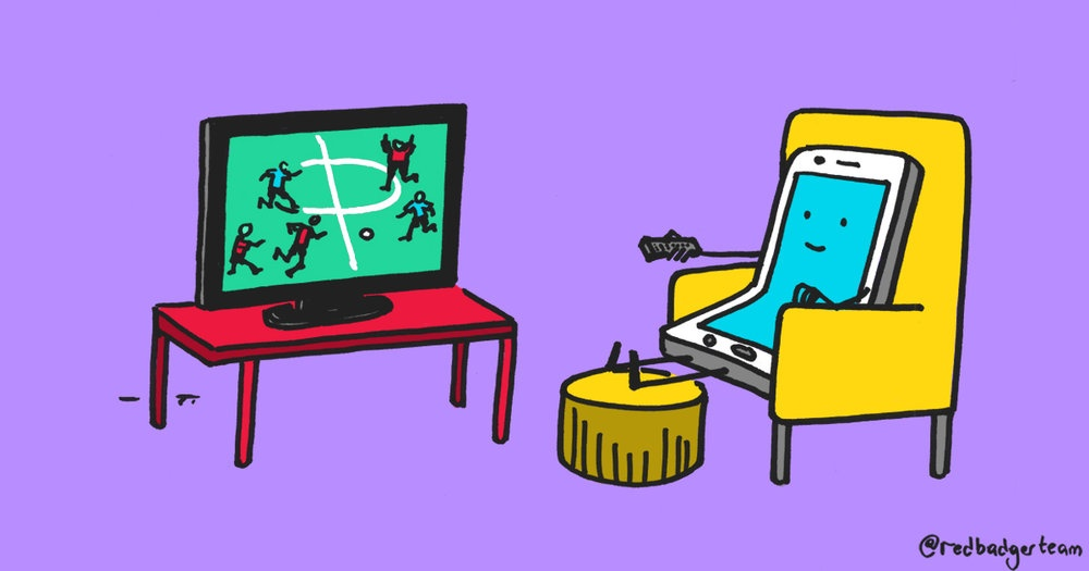 A colourful illustration of a smiling phone sat like a human in an armchair watching the football on TV.