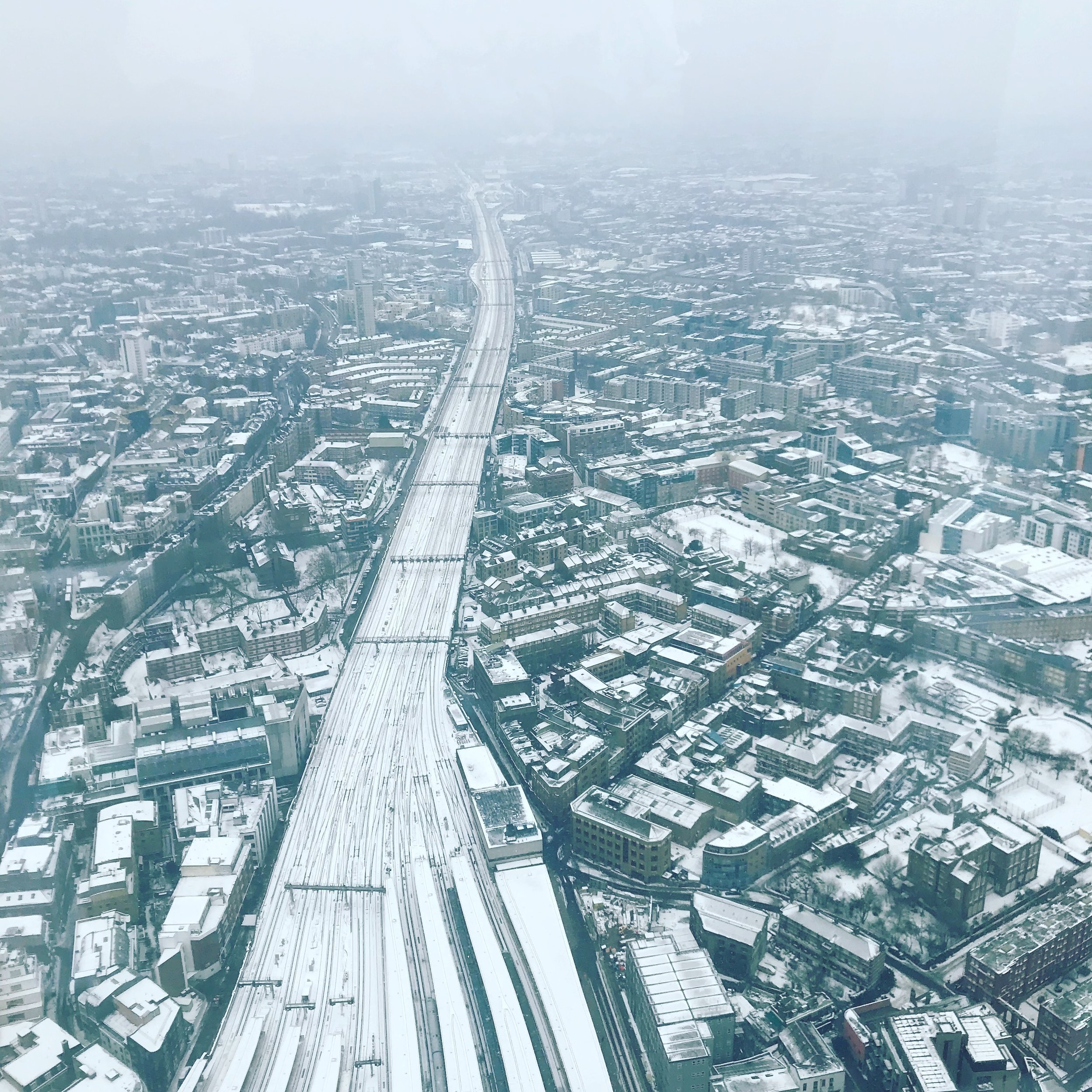 An aerial view shot of the snowy city from the Shard