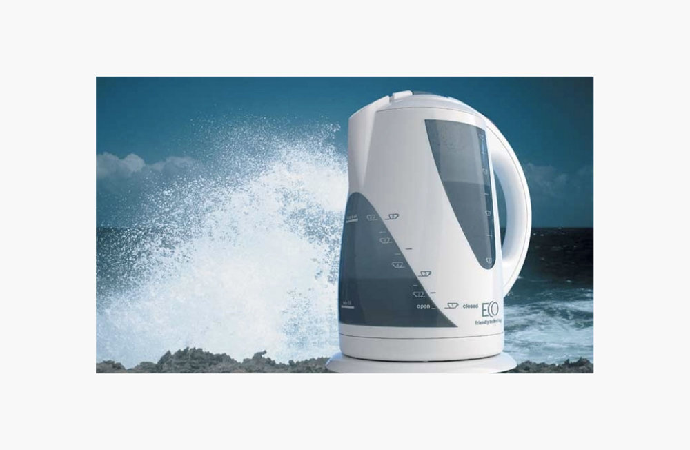 Kettle in front of crashing wave
