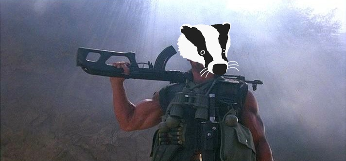 A shot of Arnold Schwarzenegger in terminator with a gun but his typically handsome face replaced with a lovely badger